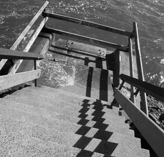 Playing with shadows is all you can do with harsh, noon sun.  These are steps leading down to Marblehead Harbor in Massachusetts.