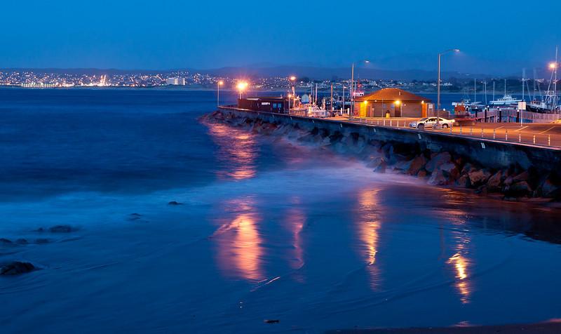 the main pier by a small public beach.