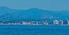 Hotel Del Coronado ~ historic landmark ~ with Coronado Bridge in the background.  Coastal mountains in the distance.