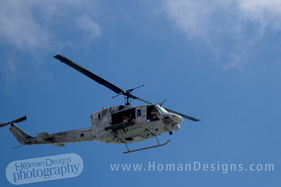 Marine  helicopter flies over Emerald Isle beach.