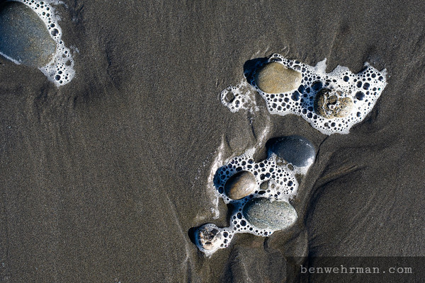 Rocks in sea foam