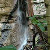 The artificial stream that flows into the waterfall pool looks almost natural.