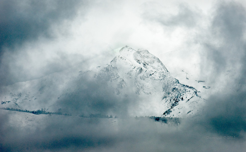 Mount Sopris seen through passing clouds.  Mount Sopris is a twin peak mountain with each peak being 12,965' above sea level.  Mount Sopris is in the Maroon Bells–Snowmass Wilderness and part of the White River National Forest.