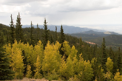 View with aspen on the way up the mountain.  Note the rain showers in the far distance.