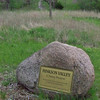 dedication boulder to the Elder and Marshall families in thanks for donating the land that is now Hinkson Valley Preserve