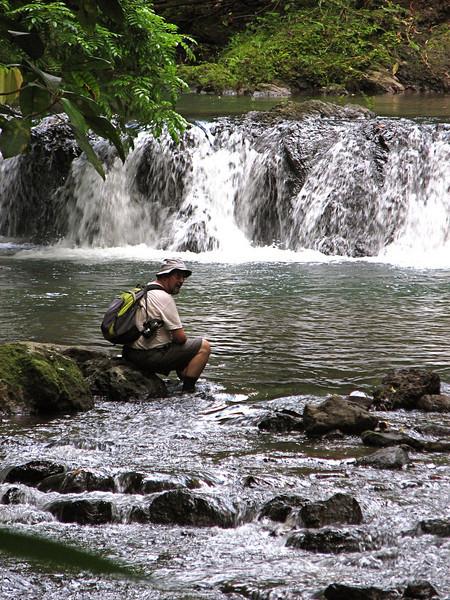 Eduardo Carrillo resting along a stream near the San Pedrillo station, Corcovado National Park, Costa Rica