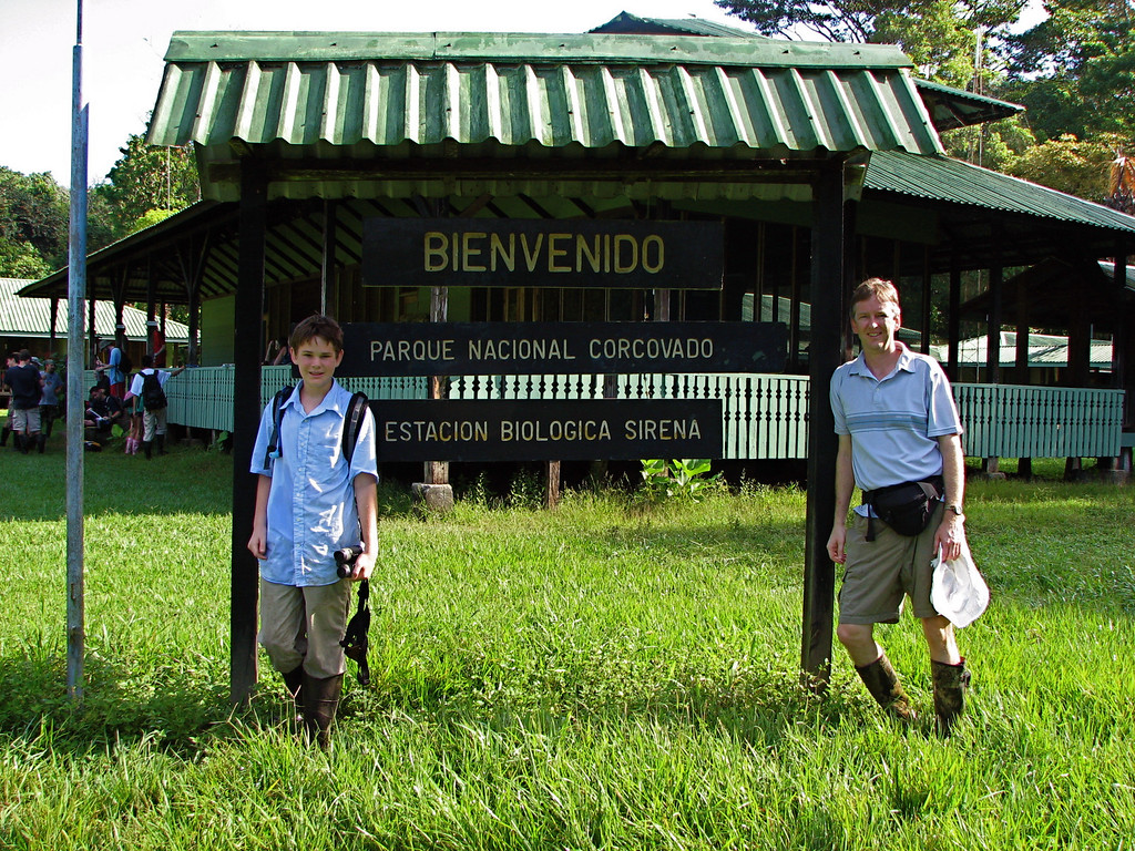 Alex and Jim at the welcome sign, Sirena station, Corcovado National Park, Costa Rica.