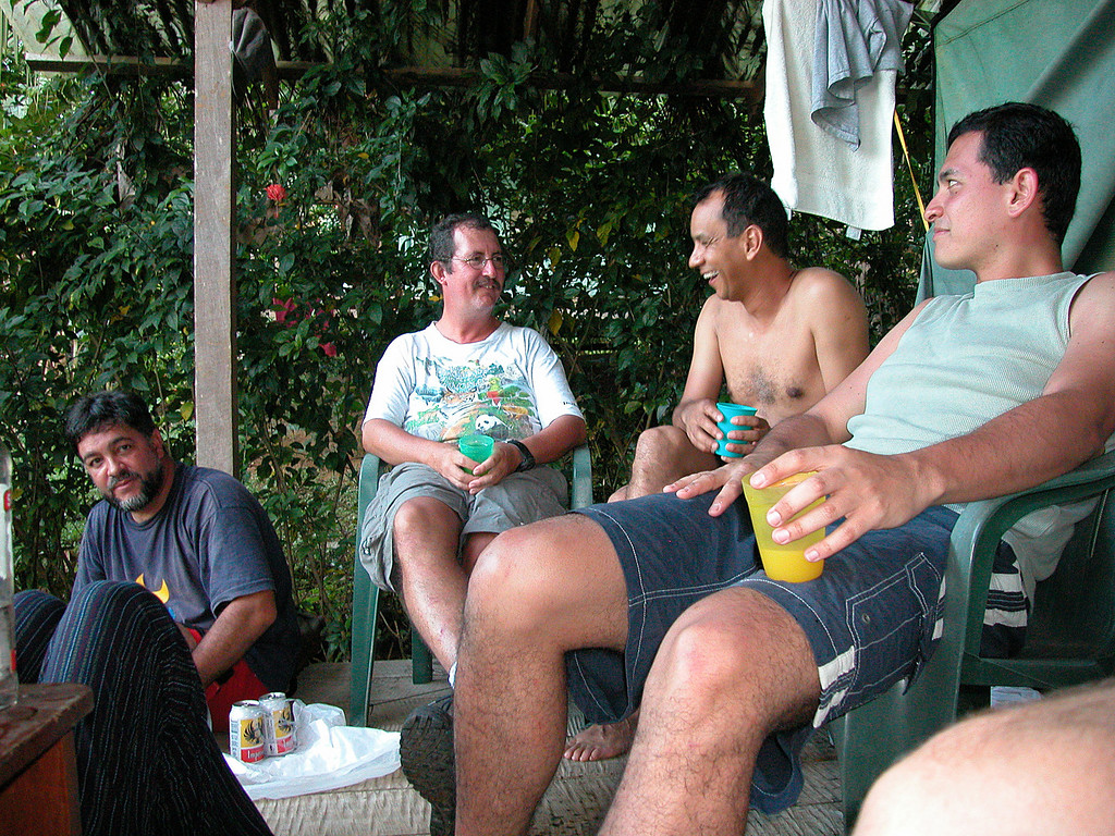 Warm drinks in a remote place.  Biologists Jose Manuel Mora, Eduardo Carrillo, Oscar Rocha, and Jorge Mena enjoy an evening cocktail at Campanario, Osa Peninsula, Costa Rica.