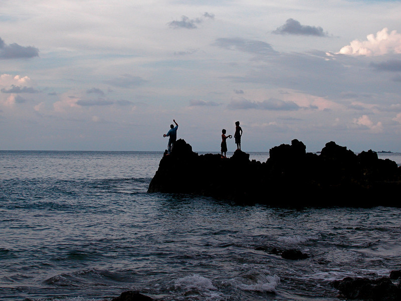 Fishing with handlines off of the rocky shore at Campanario, Osa Peninsula, Costa Rica