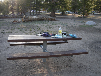 A table at the walk-in trailhead campground. A spare and elegant structure.