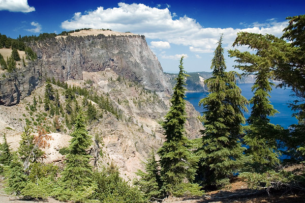 View of Crater Lake and Llao Rock on the west side of the lake from Merriam Point. Taken at the summit of the great trail we found. Looking toward the north in this photo. Absolutely beautiful location! ND70_2006-07-26DSC_5988-CraterLakeLlaoRockTrees-nice-2 copy.jpg
