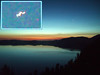 Eileen captured what appears to be a UFO hovering over Crater Lake in this early (approx 5 am) photo taken from our room at the Crater Lake Lodge. Closer examination shows a strange blur on a round object that appears to be a bright star or planet, but who knows?<br /> <br /> P7260519-CraterLakeSunriseUFO!-2 copy.jpg