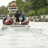 Manatee Rescue boat enters canal to rescue distressed manatee