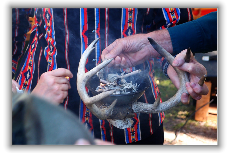 Preparing smudge pot for Seminole blessing of Three Sisters Spring