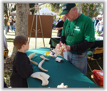 Bob Bondi of USGS explains manatee physiology to a young visitor