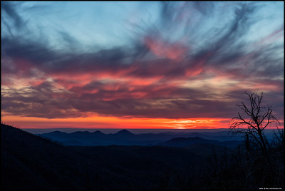 The sun setting over the cloud covered coastal region of Southern California.  This was taken on the hillside below Engineer's Road between Middle and North Peak.