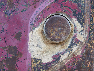 Abstract.  Close-up of oft-repainted bucket of Caterpllar wheel loader at Ryan