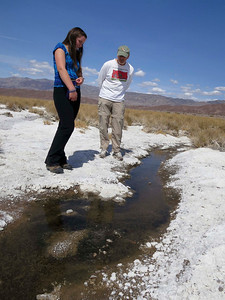 Student and instructor look for horse-fly larvae in the little creek on the salt flats.