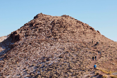 The group climbs a snow-dappled peak at Dante's View.