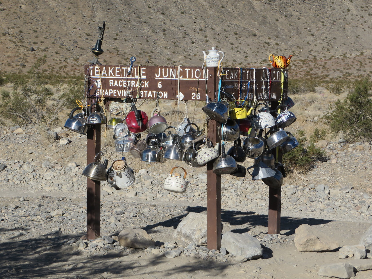 As the sign says: Teakettle Junction. Lots of travelers bring decorated and inscribed teakettles and hang them here, so many in fact that every year they are removed. The National Park had an employee who was collecting them in a Park storage area, but now that he's retired the fate of the teakettles is ambiguous. A Facebook group ( https://www.facebook.com/TeakettleJunction ) is attempting to store them, with mentions of a future museum somewhere. Not sure I'd be that interested in seeing thousands of old decorated teakettles…
