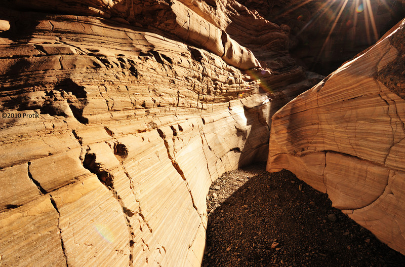 """<a href=""""http://en.wikipedia.org/wiki/Places_of_interest_in_the_Death_Valley_area#Mosaic_Canyon"""">http://en.wikipedia.org/wiki/Places_of_interest_in_the_Death_Valley_area#Mosaic_Canyon</a>"""