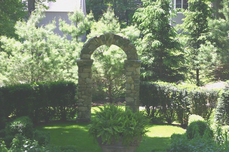 arch in sunken boxwood garden