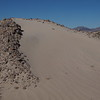 A small dune is starting by the side of the road, Mohave National Preserve, Baker, CA