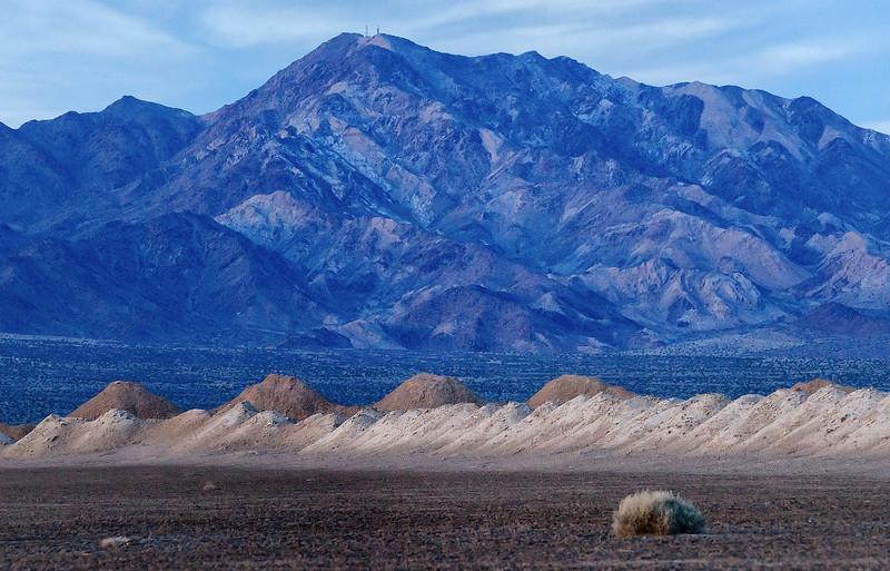 Mojave dry lake saltworks in twilight