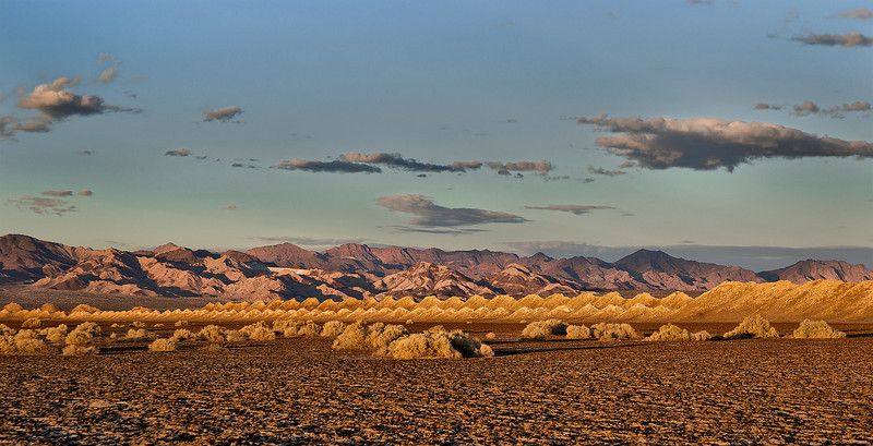 Mojave saltworks on a dry lake, at golden hour