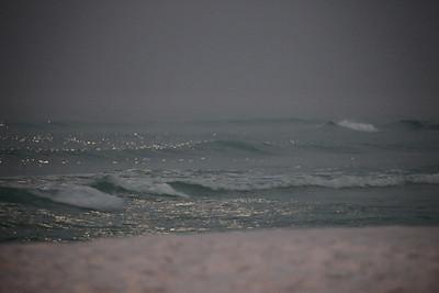 Nighttime on Destin Beach lit by moonlight.