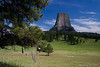 Devils Tower 8013<br /> Prayer bundles and cloths are hung from trees around Devils Tower by Native Americans. In 1906 Devils Tower became the First National Monument. Located in Wyoming, Devils Tower is also a religious site for the American Indians.  It rises 1,280 feet above the valley floor.