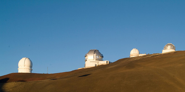 these are four of the dozen observatories on the summit. The large dome is the 8 meter Gemini North Telescope.