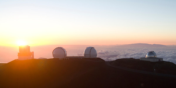 Sunset with the 8 meter Subaru telescope and  the twin Keck 10 meter telescopes.