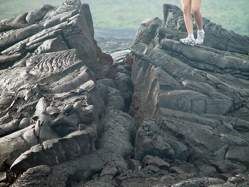 My daughter standing on a lava flow giving it some size reference.  This was pushed up and split by another lava flow.