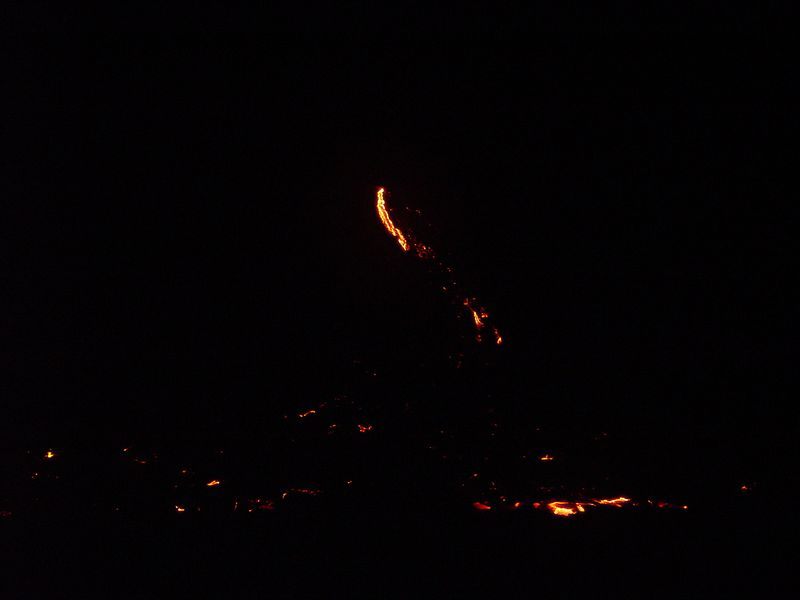 We were allowed by park rangers to stand at the bottom of the cliff (Pulama Pali)and watch the lava burn everything in it's path.  The dangerous part was walking for a few miles out to this site over un-even lava terrain. Some people suffered sprains and cuts from the razor sharp volcanic glass.