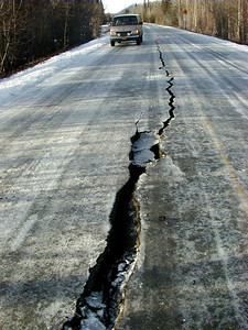 The pavement at Mile 1 on the Nabesna Road, near the Slana River Bridge, cracked as the fill tried to settle in two directions.
