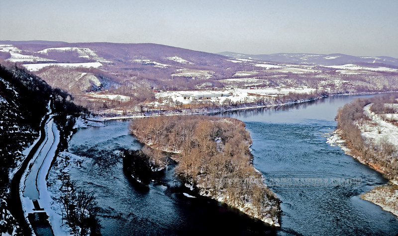 """PA-1969.3#4NI1. A view of the Lynn Islands in the Delaware River and a Delaware Canal Lock along the  """"Narrows"""" of the Nockamixon Cliffs near Kintnersville Pennsylvania. I shot this image from a point called """"Top Rock"""" on the very top of the Nockamixon Cliffs. A place inaccessible  to the public now as it is surrounded by private land. I salvaged and repaired this image from an old slide transparency. This image also shows why these cliffs are considered an eastern arctic environment as they get very little sunlight and have a number of plants growing on them that prove that. On the New Jersey side of the river down near the Milford cliffs where they get far more sunlight there are eastern Prickly Pear cactus that only grow in a warmer more arid environments."""