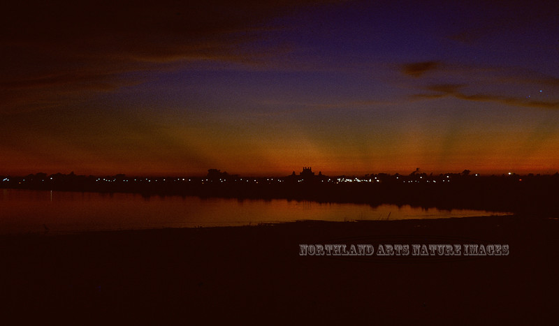 FL-1971.8#10.2. A view looking across Florida Bay at the St. Petersburg Skyline after sunset.