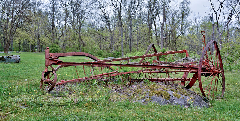 PA-2016.5.11#567.3. A vintage hayrack rests like a monument to the early settlers of rural Bucks County Pennsylvania.