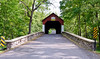PA-CBF-2020.9.14#0230.5. The Frankenfield Covered bridge is a planked town lattice truss design patented in 1820. It spans Tinicum creek on Cafferty road in Tinicum Township, Bucks County Pennsylvania.