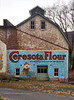 PA-D-2021.1.26#5427.3. The Historic Durham Grist Mill with a vintage Ceresota Flour Ad on a wall. This historic Grist Mill was built on the foundation of the Durham Furnace in 1819. Old Durham Road, Durham, Bucks County Pennsylvania. Photo by Guy J.