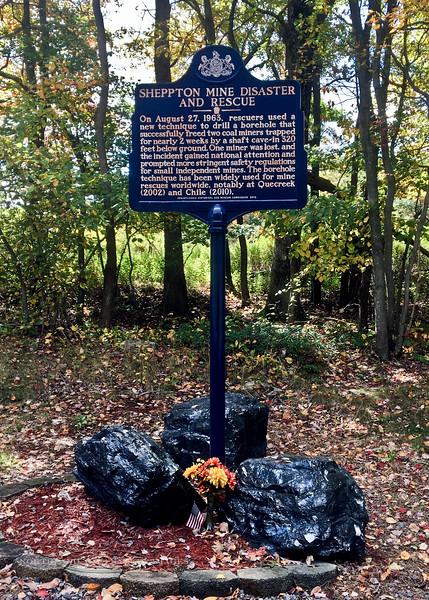 PA-2020.10.2#5117.3. Sheppton Mine Disaster and Rescue Interpretive sign. Surrounded by three large chunks of the Anthracite Coal the Miners were digging for in the Oneida NO. 2 Slope. Schuylkill County, Pennsylvania. Photo by Guy J.