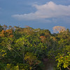 Hiking up to an open ridge overlooking the rainforest and the Tiputini River that boarders Yasuni National Park I photographed the sun setting.  Located in the Ecuadorian Amazon, Yasuni National Park is an Unesco Bioshpere Reserve and World Heritage Site.