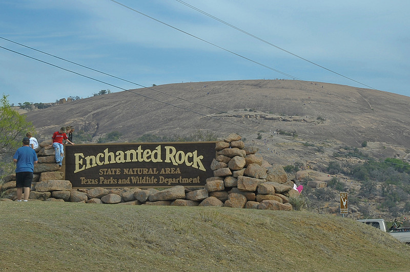 Those tiny objects you see on the large dome are people climbing around the main dome of Enchanted Rock. Put on your hiking shoes, and let's take a little journey around a very unusual and enchanting place.