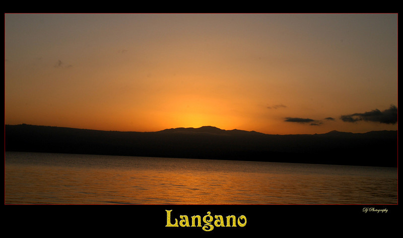 Sunset over Langano<br /> <br /> Langano is a lake in the Oromia Region of Ethiopia, about 100 km south of the capital, Addis Ababa, on the border between the Misraq Shewa and Arsi Zones. It is located in the Great Rift Valley at an elevation of 1585 meters to the east of Lake Abijatta. According to figures published by the Central Statistical Agency, Lake Langano is 18 kilometers long and 16 km wide, with a surface area of 230 square kilometers and a maximum depth of 46 meters.[1]