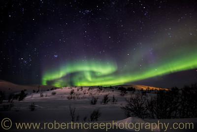 Aurora in the Hills Above Batsfjord