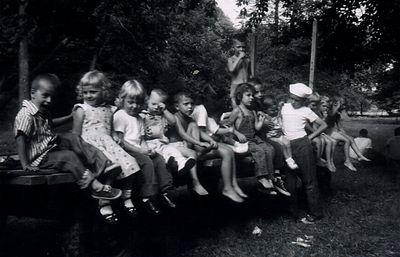 August 1958 haywagon ride at the family farm. Steve is sitting towards the center of the wagon, and Cathy is the little girl with the bib overalls on.