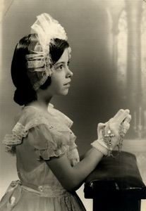 Posing for my first communion photograph. Age 7 or 8.