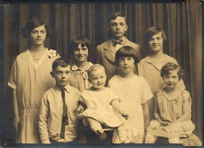 Dads childhood family portrait  taken around 1927 when he was around 8  years old.  (back row L-R) Odile, Gert, Ray, Marge. (front row) Archie, Hal, Eileen, Theresa.