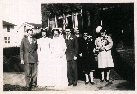 Mom (Dorothy) & Dads (Archie) wedding day, Uncle Hal as best man, Aunt Pat as maid of honor, with both sets of parents in the background.